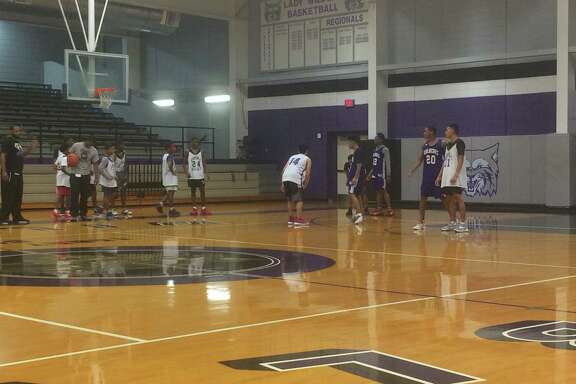 The Humble boys basketball team practices at the gym at Humble High School on October 27.