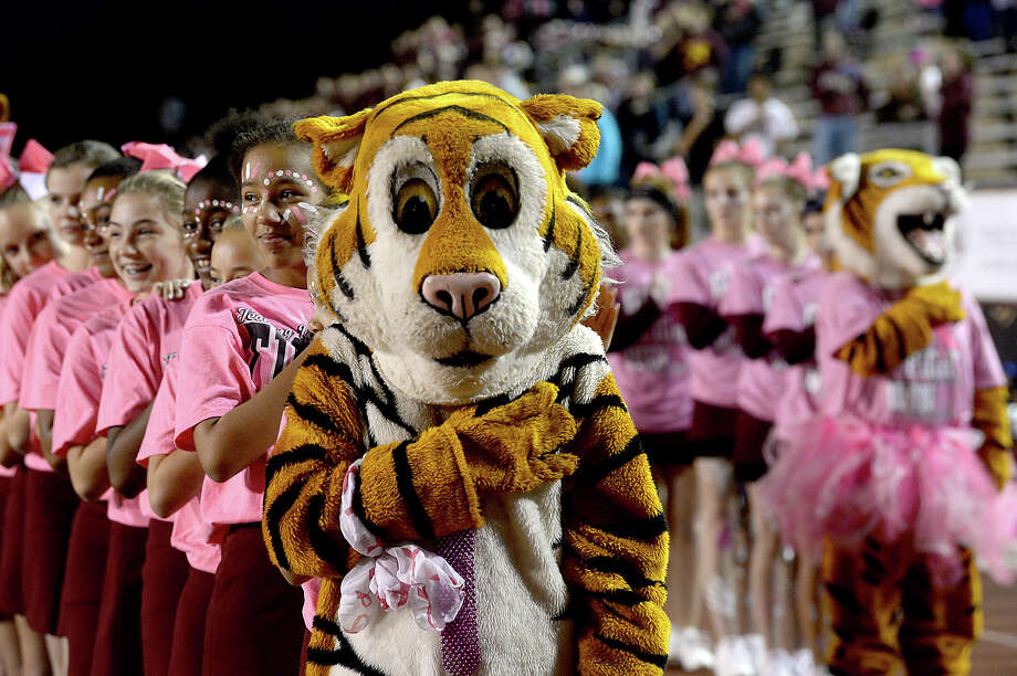 Silsbee's cheer squads observe the anthem as they get ready to face Bridge City during their district game Friday night in Silsbee. Photo taken Friday, October 27, 2017 Kim Brent/The Enterprise Photo: Kim Brent / BEN