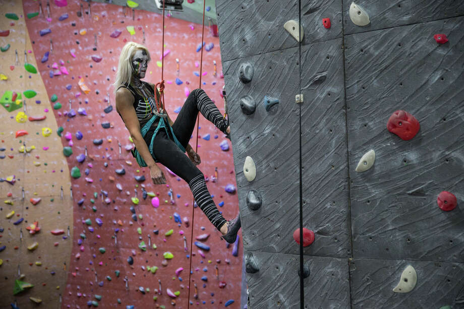 A climber in costume descends a route during Vertical World Seattle's annual Halloween Lights Out climb on Friday, Oct. 27, 2017. Photo: GRANT HINDSLEY, SEATTLEPI.COM / SEATTLEPI.COM