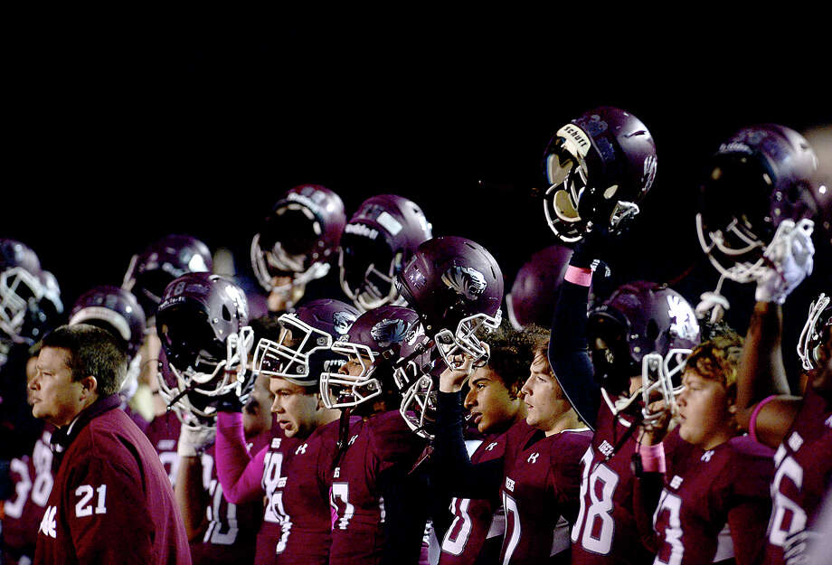 Silsbee's Varsity raise their helmets as they await opening kick-off against Bridge City's Cardinals during their district game Friday night in Silsbee. Photo taken Friday, October 27, 2017 Kim Brent/The Enterprise Photo: Kim Brent / BEN