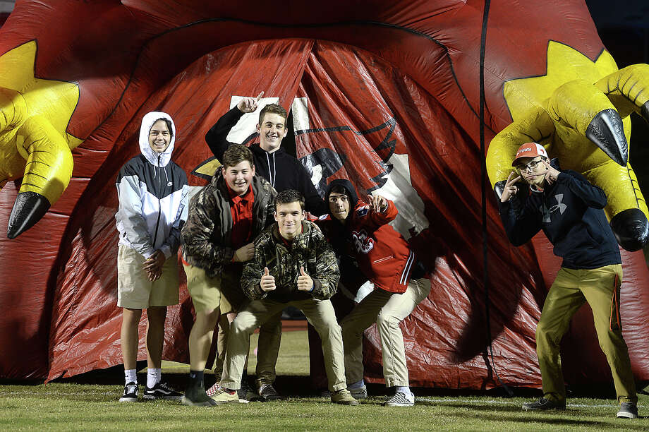 Bridge City's spirit squad pose at their inflatable during their district game Friday night in Silsbee. Photo taken Friday, October 27, 2017 Kim Brent/The Enterprise Photo: Kim Brent / BEN