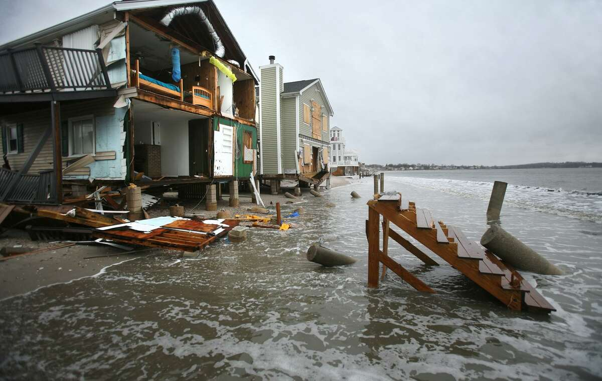 Storm tides reach waterfront homes devastated by Superstorm Sandy on East Broadway in Milford on Thursday, December 27, 2012.