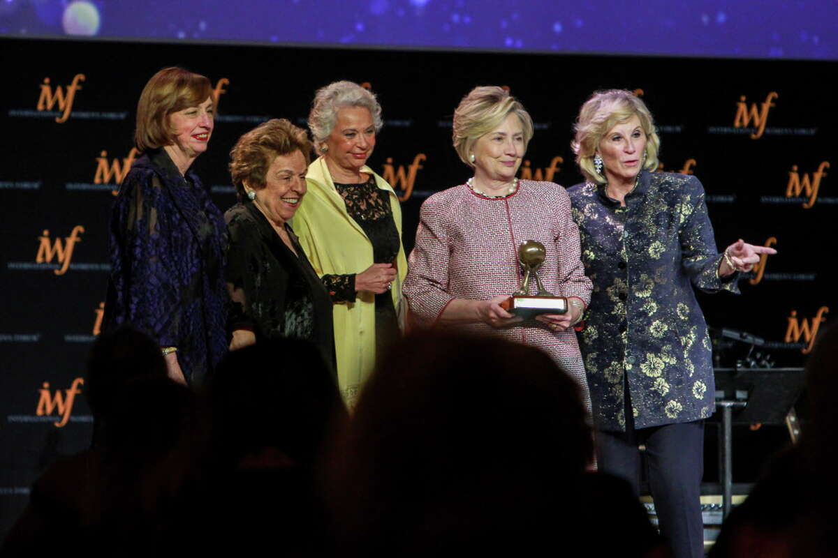 Ann Drake, from left, Donna Shalala, Olga Sanchez Cordero, Hillary Rodham Clinton and Donna De Varona, after Clinton was inducted into the IWF and Leadership Foundation Hall of Fame at the International Women's Conference gala. (For the Chronicle/Gary Fountain, October 27, 2017)