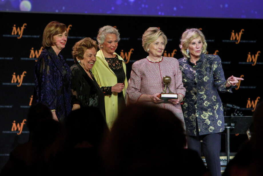 Ann Drake, from left, Donna Shalala, Olga Sanchez Cordero, Hillary Rodham Clinton and Donna De Varona, after Clinton was inducted into the IWF and Leadership Foundation Hall of Fame at the International Women's Conference gala.  (For the Chronicle/Gary Fountain, October 27, 2017) Photo: Gary Fountain, Gary Fountain/For The Chronicle / Copyright 2017 Gary Fountain