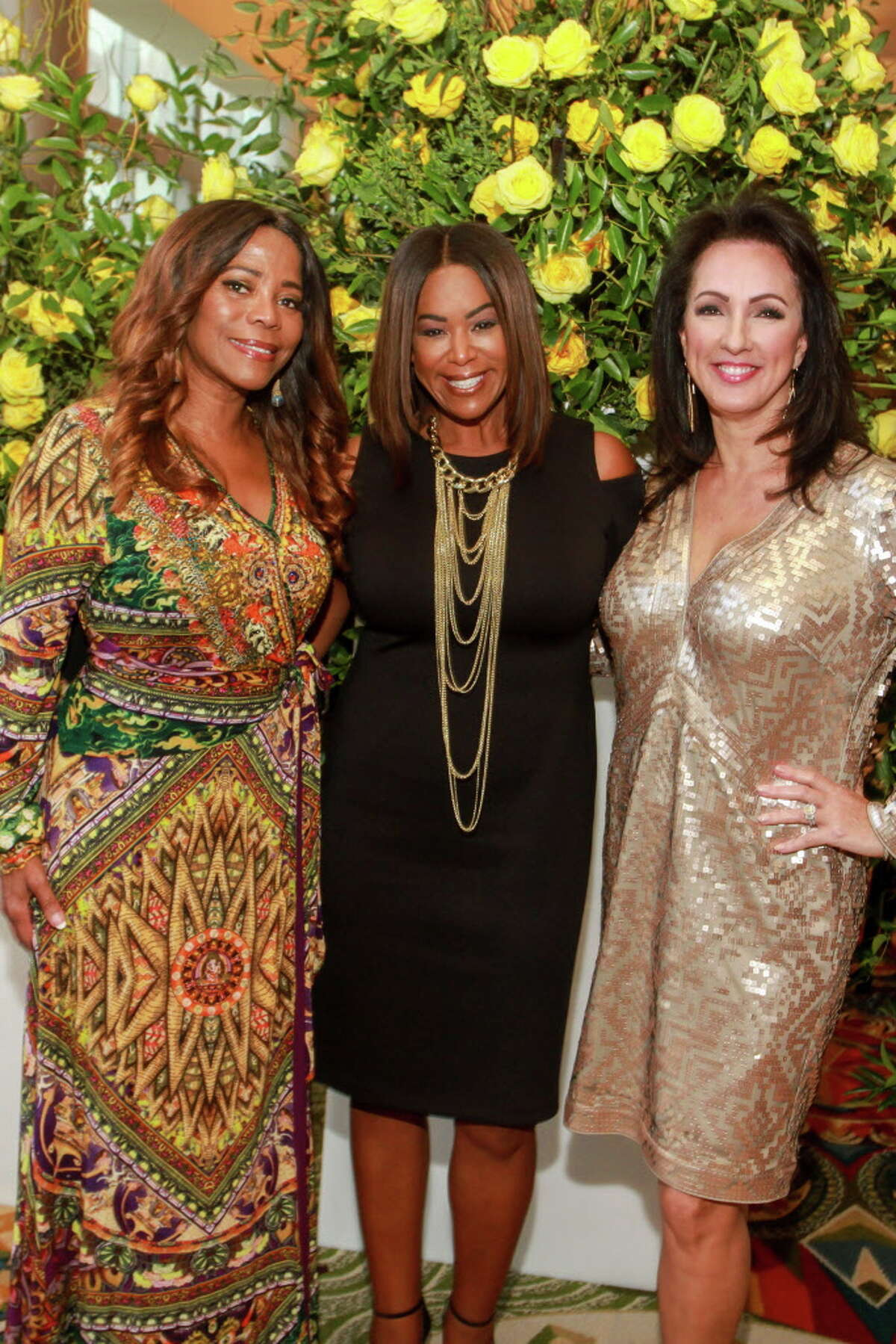 Darian Ward, from left, Deborah Duncan and Alicia Smith at the International Women's Conference gala. (For the Chronicle/Gary Fountain, October 27, 2017)