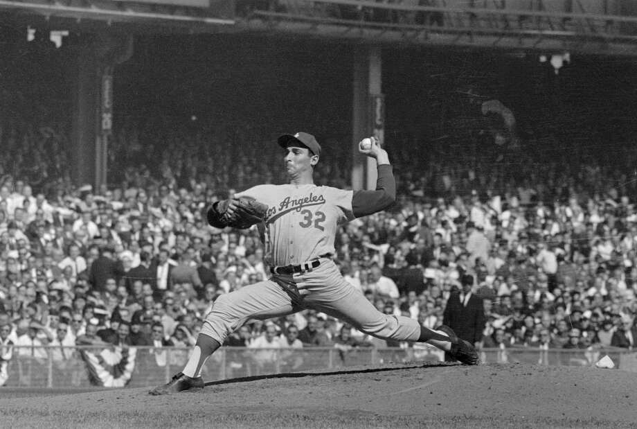 Sandy Koufax pitches in the 1963 World Series for the Dodgers against the Yankees. Photo: Bettmann / Contributor