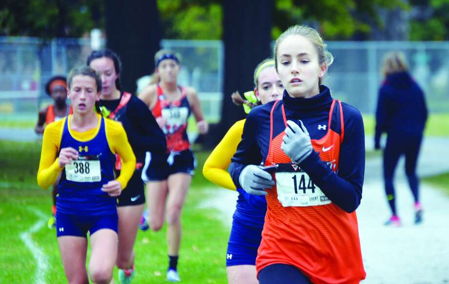 EHS runner Hannah Stuart, right, competes in the girls' race at Wilson Park.