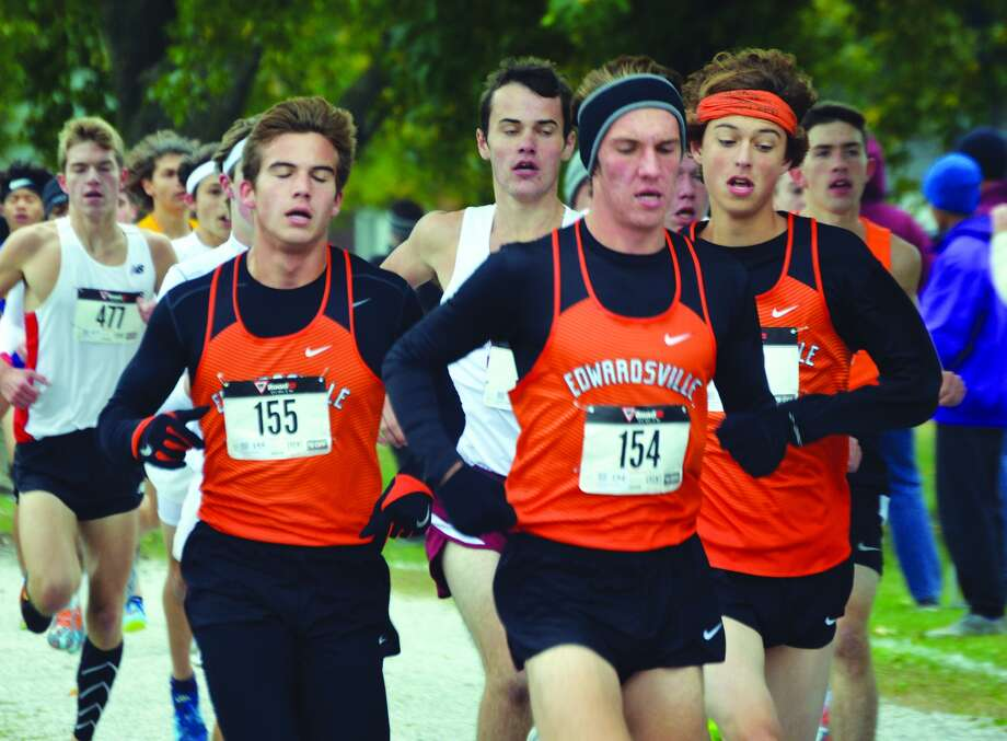 EHS runners Franky Romano, left, Roland Prenzler, center, and Max Hartmann compete in the boys' race of the Class 3A Granite City Sectional.