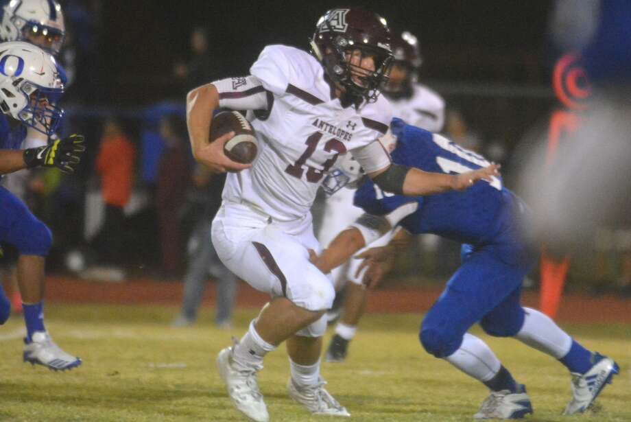 Abernathy quarterback Bryson Daily evades a tackler in a game against Olton last week. The sophomore signal-caller ran for three touchdowns and 130 yards to help the Antelopes defeat Floydada Friday night and remain unbeaten. Photo: Skip Leon/Plainview Herald