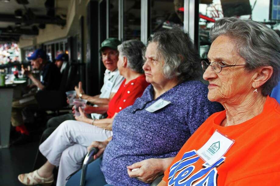 Giovanna Marrone, right, Christina Lovallo, second from right, and other members of the River House Adult Day Center's Baseball Reminiscence Program watch the New York Mets at Citi Field in Queens, New York, in July 2017. Photo: John Breunig / Hearst Connecticut Media / Greenwich Time