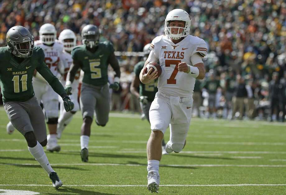 WACO, TX - OCTOBER 28: Shane Buechele #7 of the Texas Longhorns runs for a touchdown as Jameson Houston #11 and Brian Nance #5 of the Baylor Bears pursue in the first half at McLane Stadium on October 28, 2017 in Waco, Texas. Photo: Ron Jenkins, Getty Images / 2017 Getty Images