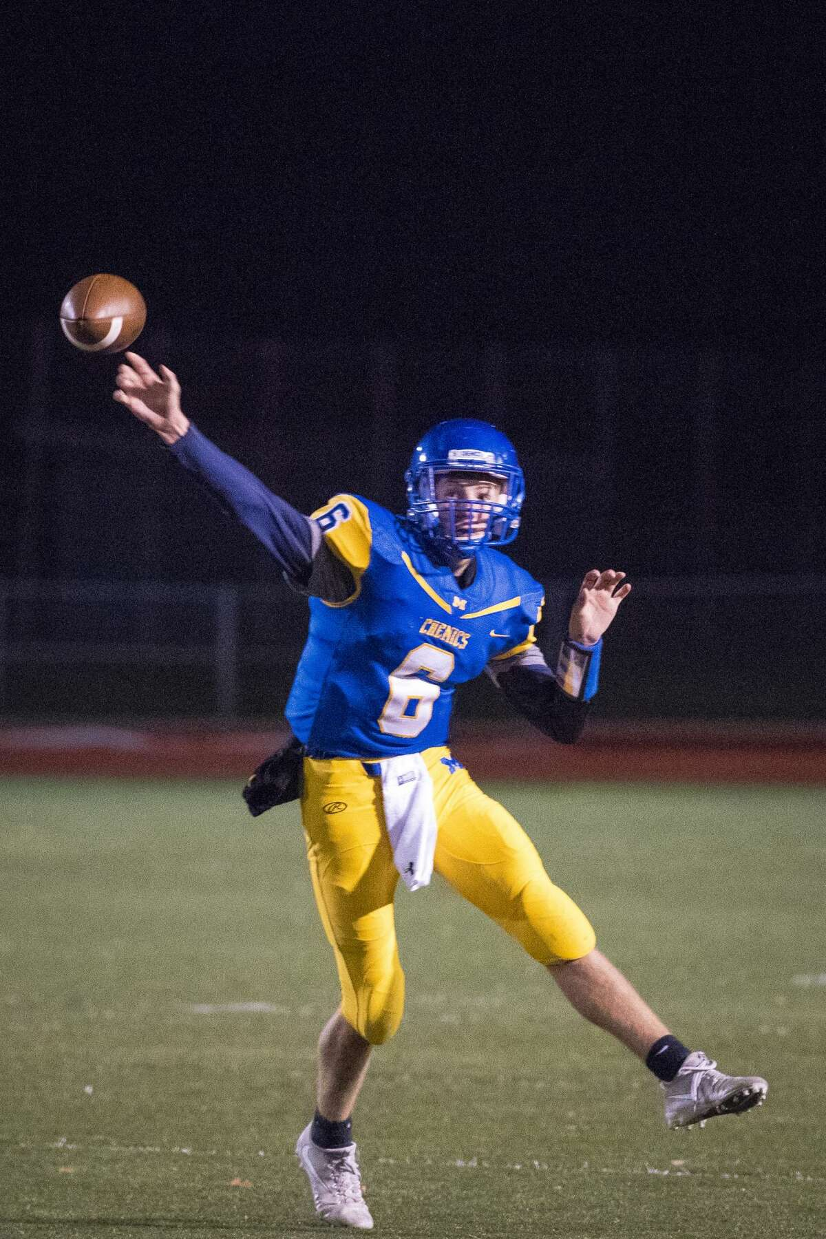 Midland quarterback, senior Cade Methner, throws a pass during the district semifinals against Traverse City Central on Friday, Oct. 27, 2017 in Midland. (Danielle McGrew Tenbusch/for the Daily News)