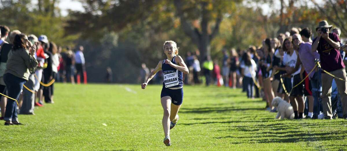 Wilton Morgan McCormick sprints to a first place finish the FCIAC Girls Cross Country Championships at Waveny Park in New Canaan, Connecticut on Wednesday, Oct.18, 2017. McCormick cross the finish line with a time of 13:44.83.