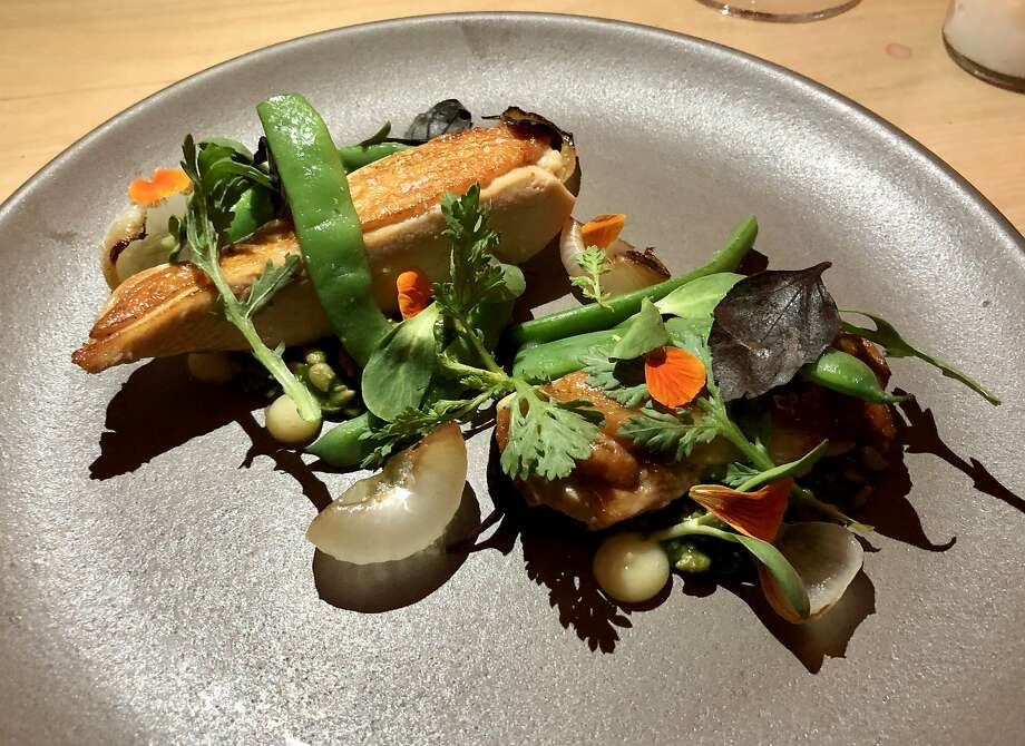 Young hen with sunflower-seed porridge, romano beans, lemon jam and charred onions at Commonwealth in S.F. Photo: Michael Bauer, The Chronicle