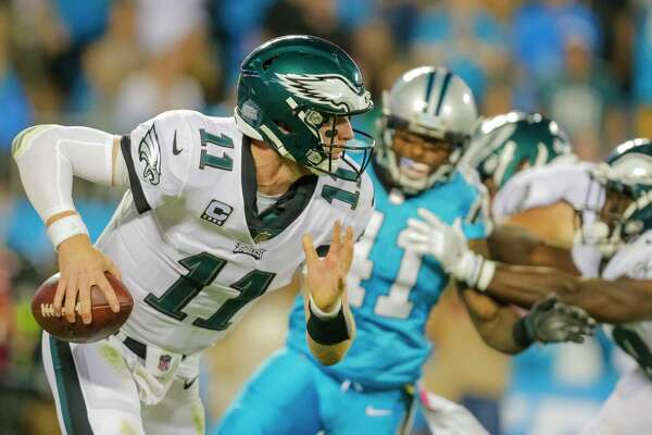 Philadelphia Eagles' Carson Wentz (11) scrambles out of the pocket against the Carolina Panthers during the first half of an NFL football game in Charlotte, N.C., Thursday, Oct. 12, 2017. The Eagles won 28-23. (AP Photo/Bob Leverone)