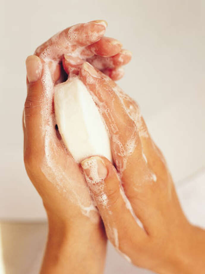 Sudsy saver: When you have the remnants of a bar of soap, use warm water to mold it together with a larger piece. A bigger piece of soap will also work faster for sudsing up larger patches of skin. Photo: Image Source / (c) Image Source