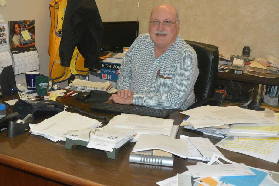 Plainview Herald Editor Doug McDonough still has a full desk just days before his retirement. After 41 years at the Herald, including the last five and a half as editor, Doug's last day will be Tuesday. Photo: Skip Leon/Plainview Herald