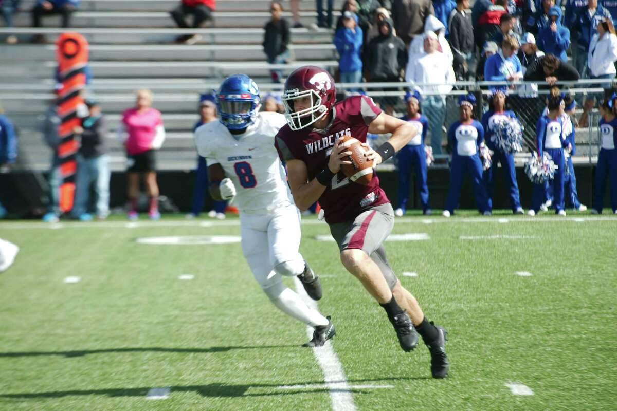 Clear Creek's Sam Mathews (2) scrambles for yardage against Dickinson Saturday, Oct 28 at Clear Creek High School.