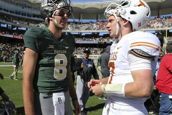 Baylor quarterback Zack Smith, left, talks with Texas quarterback Shane Buechele, right, following an NCAA college football game, Saturday, Oct. 28, 2017, in Waco, Texas. Texas won 38-7. (AP Photo/Rod Aydelotte)
