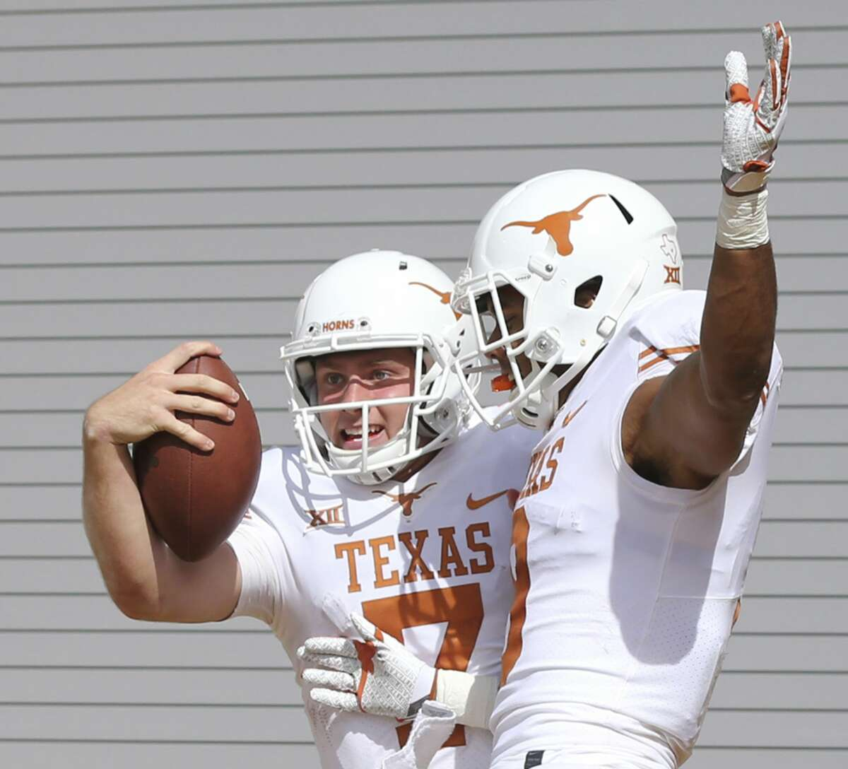 Texas quarterback Shane Buechele, left, celebrates his touchdown against Baylor with wide receiver Collin Johnson, right, in the first half of an NCAA college football game, Saturday, Oct. 28, 2017, in Waco, Texas. (AP Photo/Rod Aydelotte)