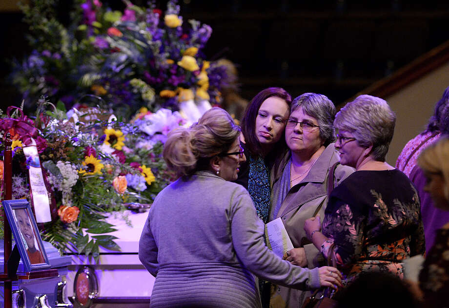 Family and friends console one another at Cathedral in the Pines Church as they gather around the caskets during the opening visitation of the funeral service for Ashley Pickering and her five children, all of whom died in a fire at their home in Silsbee October 18. Photo taken Saturday, October 28, 2017 Kim Brent/The Enterprise Photo: Kim Brent / BEN