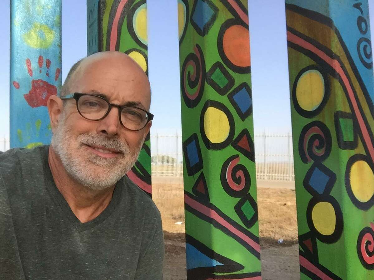 John Thomas, Quinnipiac University law professor, in Tijuana, Mexico where he interviewed locals about the eight prototype border walls be built across the border in Otay Mesa, California by the federal government.