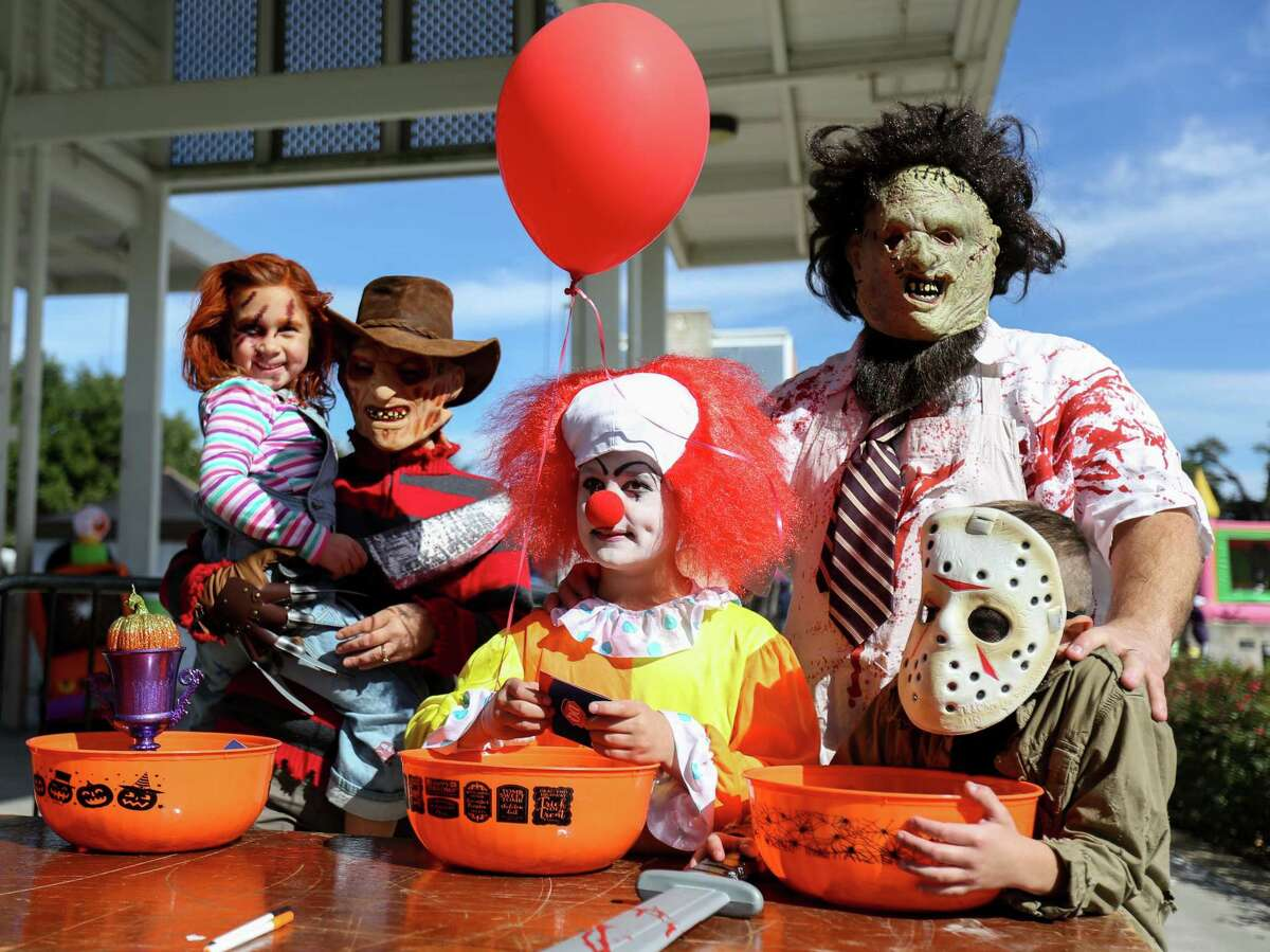The Moon family from the left: Emery, 5, Nikki, Brett, 10, Frank and Lance, 7, pose for photos after taking first and second places in the children's costume contest during the 2nd Annual Truck or Treat Halloween Family Food Festival on Saturday, Oct. 28, 2017, in downtown Conroe.