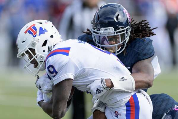 Destri White (6) of the Rice Owls tackles Teddy Veal (9) of the Louisiana Tech Bulldogs in the first half in a Conference USA football game on Saturday, October 28, 2017 at Rice Stadium in Houston Texas.