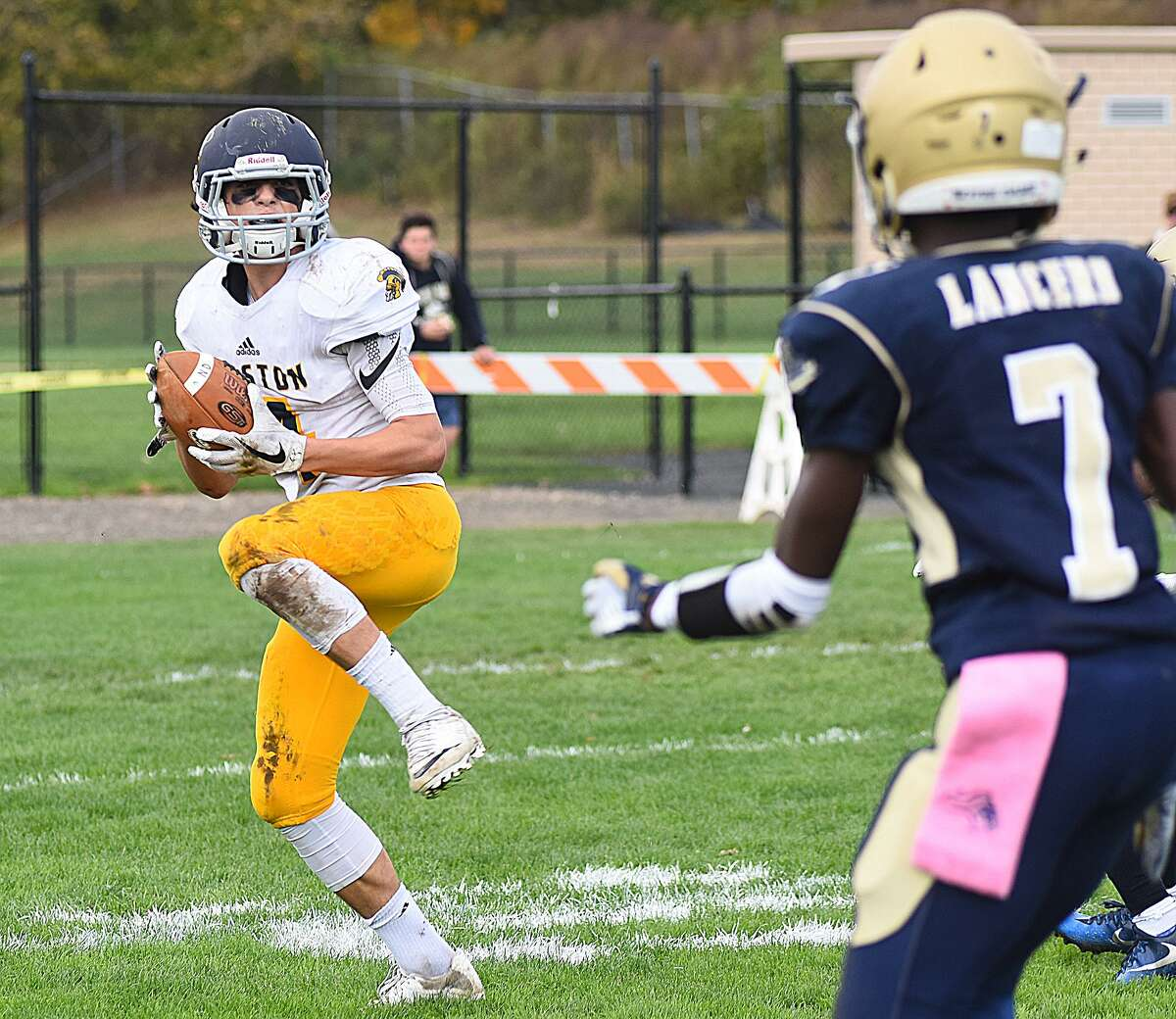 Weston's James Goetz, left, snatches the first of five Trojan interceptions during the first half of Saturday's SWC matchup against Notre Dame-Fairfield in Fairfield. Weston won the game 35-19.