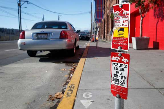 Signs advise motorists of two separate restrictions depending on the time of day at one parking space on the 300 block of Townsend Street in San Francisco, Calif. on Saturday Oct. 28, 2017. Recent figures indicate that more parking tickets were issued on Townsend between 4th and 5th streets than anywhere else in the city.