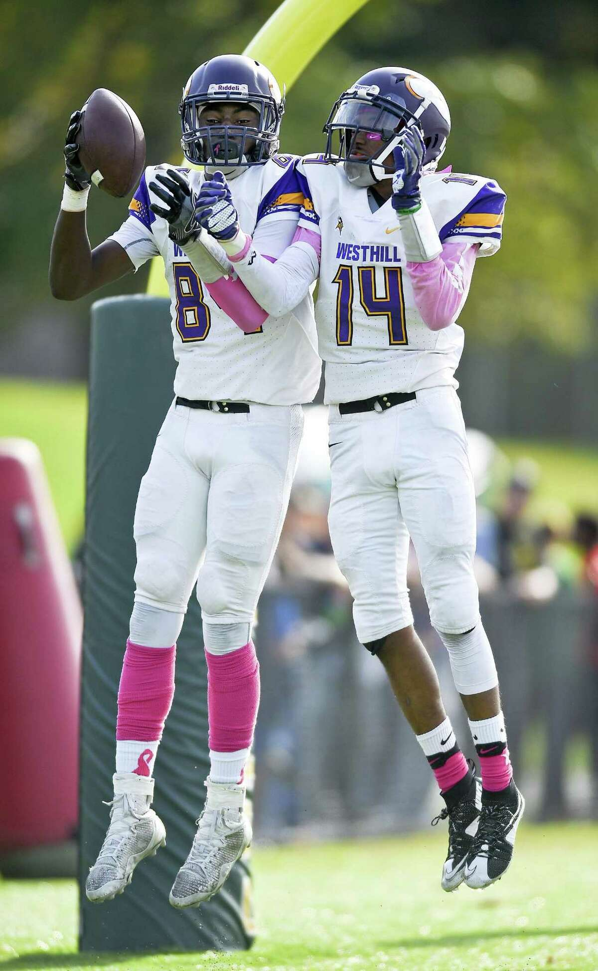Westhill's Wyklend Turenne (84) celebrates his touchdown with teammate D'aeren Carson (14) during the Vikings' contest with Stamford rival Trinity Catholic Saturday. Westhill won 30-17.