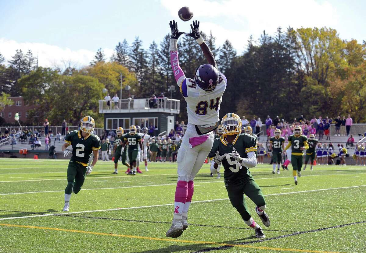 Westhill Wyklend Turenne (84) makes a reception for a touchdown against Trinity Catholic Dwayne Liles (9) in a inner city varsity boys football game at Gaglio Field in Stamford, Connecticut on Saturday, Oct. 28, 2017. Westhill defeated Trinity Catholic 30-17.