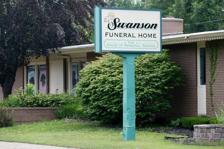 FILE- In a July 12, 2017 file photo, the Swanson Funeral Home is seen on Martin Luther King Avenue in Flint, Mich. The state has shut down the funeral home, saying maggots were in a garage where unrefrigerated bodies were being stored. (Terray Sylvester/The Flint Journal-MLive.com via AP) Photo: Terray Sylvester, MBO / The Flint Journal-MLive.com