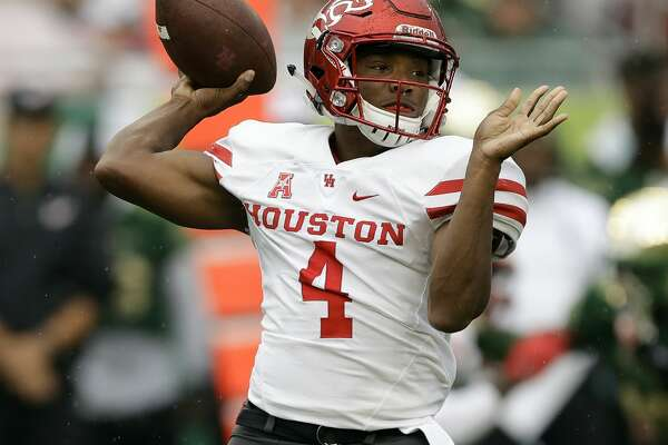 Houston quarterback D'Eriq King throws a pass against South Florida during the first half of an NCAA college football game, Saturday, Oct. 28, 2017, in Tampa, Fla. (AP Photo/Chris O'Meara)