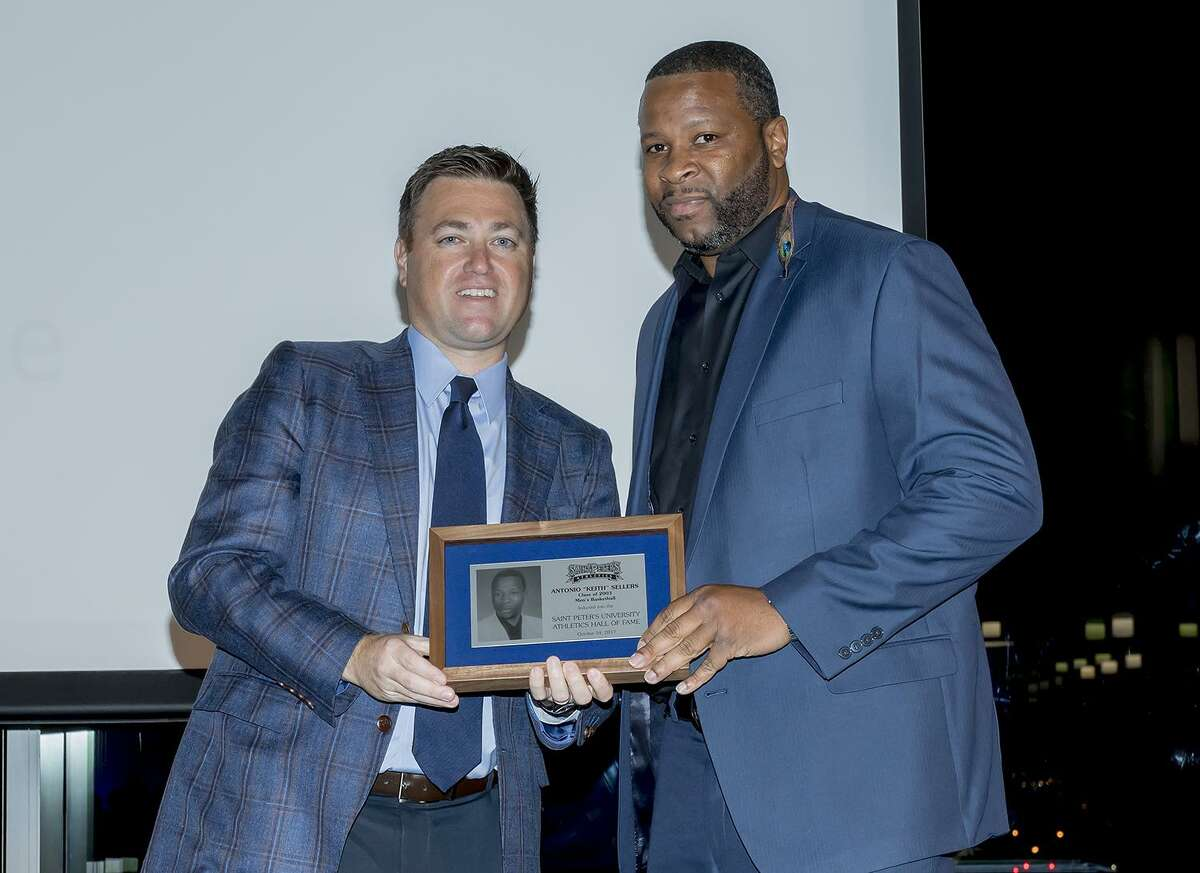 Former Norwalk High School basketball standout Keith Sellers accepts his St. Peter's University Athletic Hall of Fame Award from Athletic Director Bryan Felt.