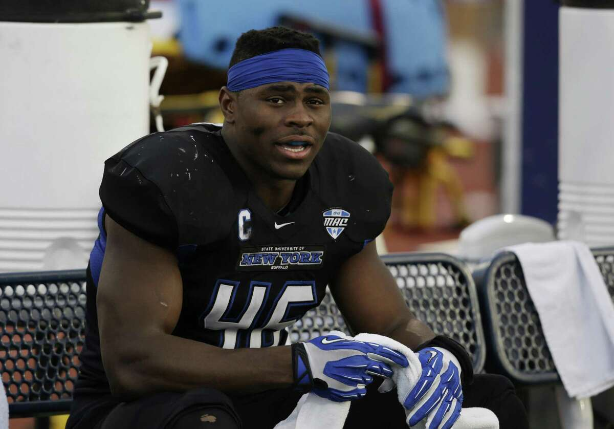 Buffalo linebacker Khalil Mack (46) sits on the team bench during the second half of an NCAA college football game against Connecticut on Saturday, Sept. 28, 2013, in Buffalo, N.Y. Buffalo won, 41-12. (AP Photo/Mike Groll)