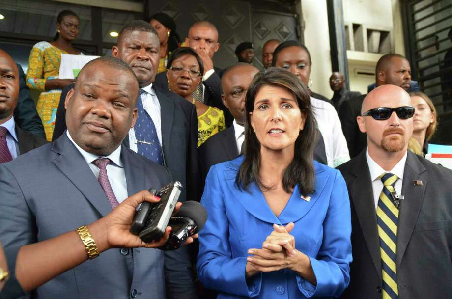 Nikki Haley, U.S. ambassador to the United Nations, centre, meets with President of Congo's Election commission, Corneil Nangaa, left, during a meeting in Kinshasa, Congo, Friday, Oct. 27, 2017. The U.S. ambassador to the United Nations says Congo will not have the help of the international community if elections are not held in 2018.  (AP Photo/John Bompengo) Photo: John Bompengo, STR / Copyright 2017 The Associated Press. All rights reserved.