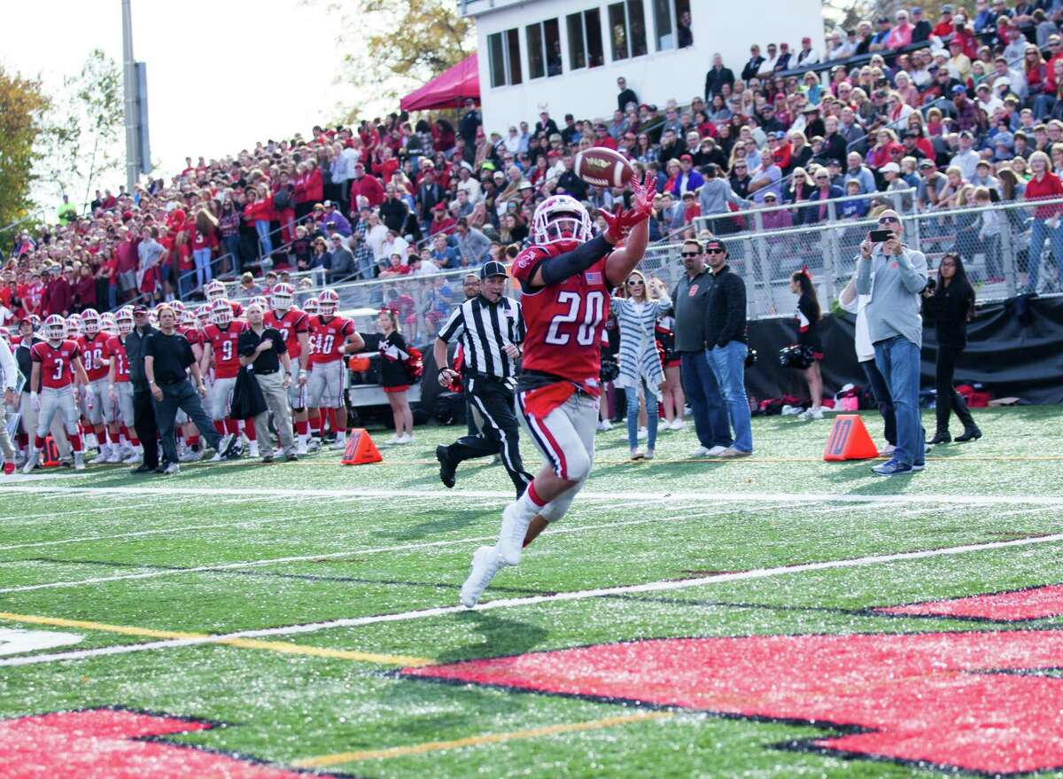 New Canaan receiver Quintin O'Connell hauls in one of his three touchdowns during a football game between New Canaan and Pascack Valley of New Jersey on Saturday, Oct. 28, 2017 at Dunning Stadium in New Canaan, Conn. New Canaan defeated Pascack Valley 33-14.