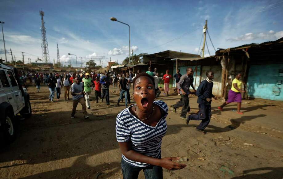 An opposition protester reacts as she hears rumours that opposition leader Raila Odinga was coming to visit them, causing thousands to turn out on the streets but which later turned out to be untrue, in the Kawangware area of Nairobi, Kenya, Saturday, Oct. 28, 2017.  Kenyan opposition areas were generally calmer Saturday, though clashes between supporters of opposition leader Raila Odinga and police continued in Kawangware, and it was still not clear when the presidential election, a rerun of the flawed vote in August, would be over. (AP Photo/Ben Curtis) Photo: Ben Curtis, STF / Copyright 2017 The Associated Press. All rights reserved.