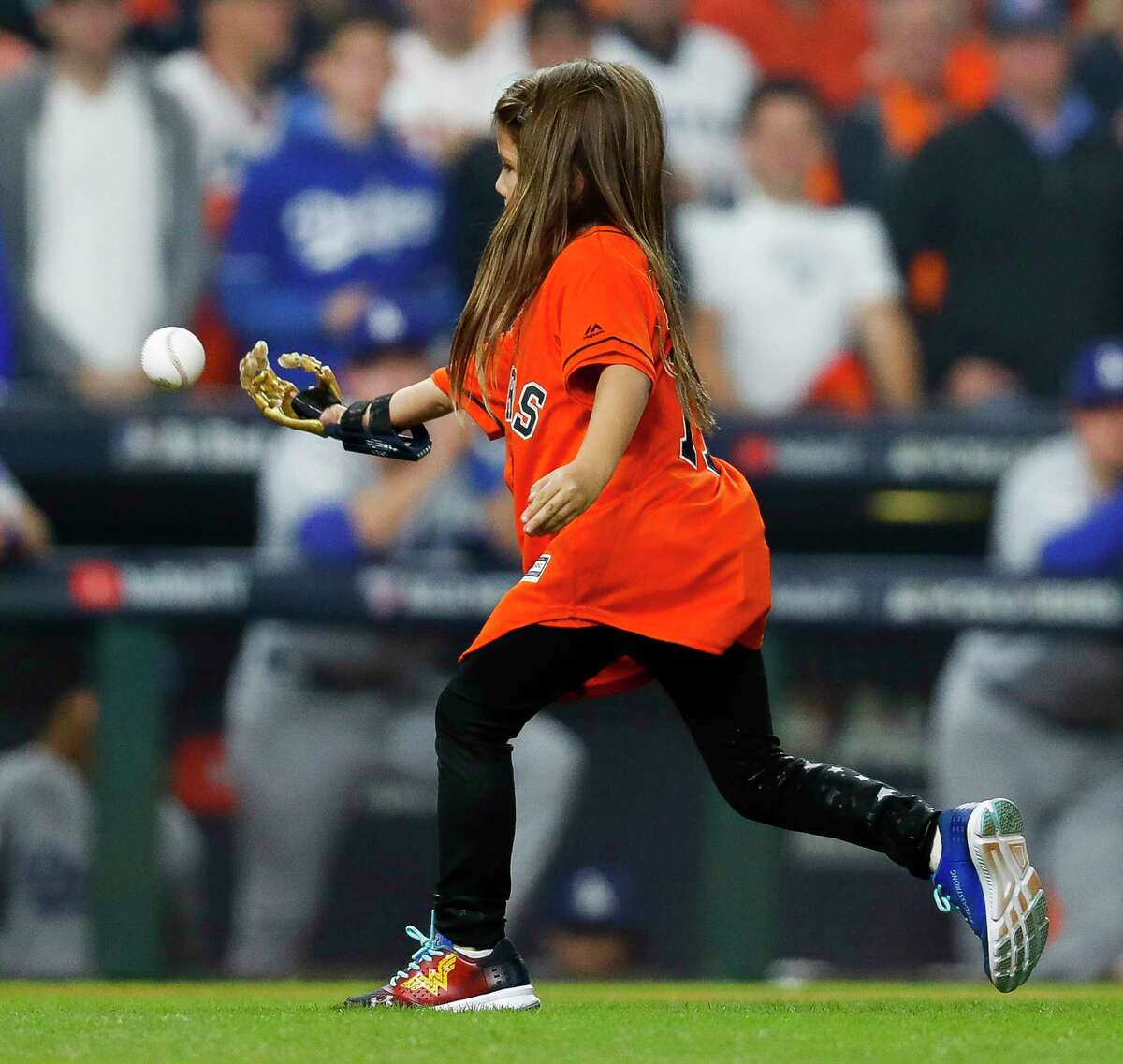 Hailey Dawson, 7, who uses a 3D printed prosthetic hand, throws out the ceremonial first pitch of Game 4 of the World Series at Minute Maid Park on Saturday, Oct. 28, 2017, in Houston.