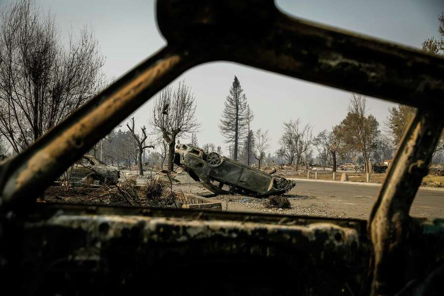 A car sits flipped over on Dogwood Drive in Santa Rosa's Coffey Park neighborhood on Wednesday, October 18, 2017. The Northern California wildfires created tornadolike winds leaving vehicles strewn throughout the neighborhood. Photo: Gabrielle Lurie / The Chronicle / ONLINE_YES