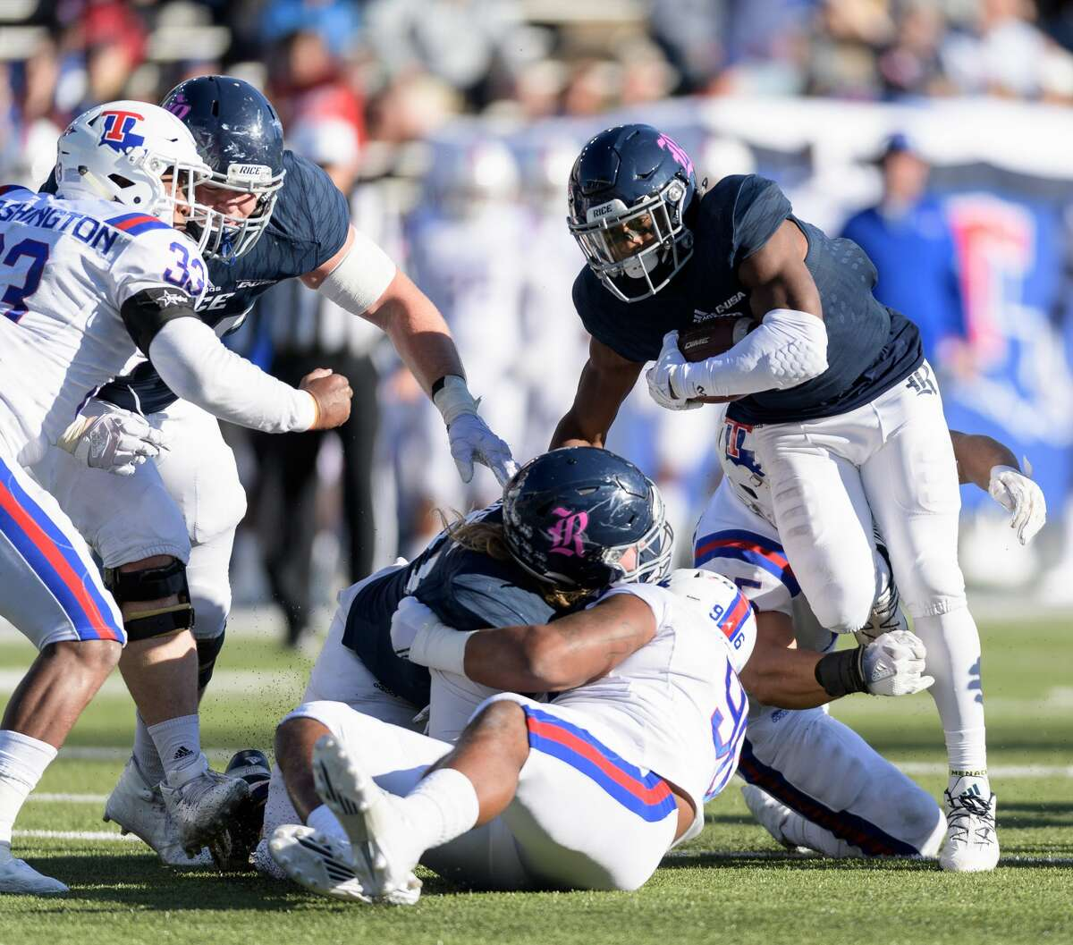 Austin Walter (2) of the Rice Owls is one of five FBS players this season who has rushing and receiving gains of at least 70 yards.