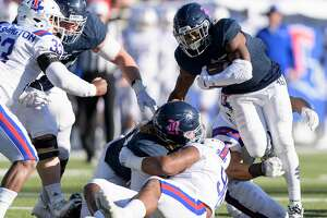 Austin Walter (2) of the Rice Owls runs up the middle for a short gain in the second half against the Louisiana Tech Bulldogs in a Conference USA football game on Saturday, October 28, 2017 at Rice Stadium in Houston Texas.