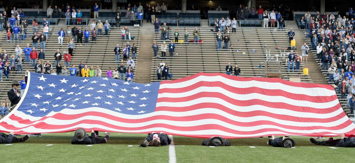 Members of Rice's Marching Owl Band hold the American flag during the National Anthem prior to their game with the Louisiana Tech Bulldogs in a Conference USA football game on Saturday, October 28, 2017 at Rice Stadium in Houston Texas.