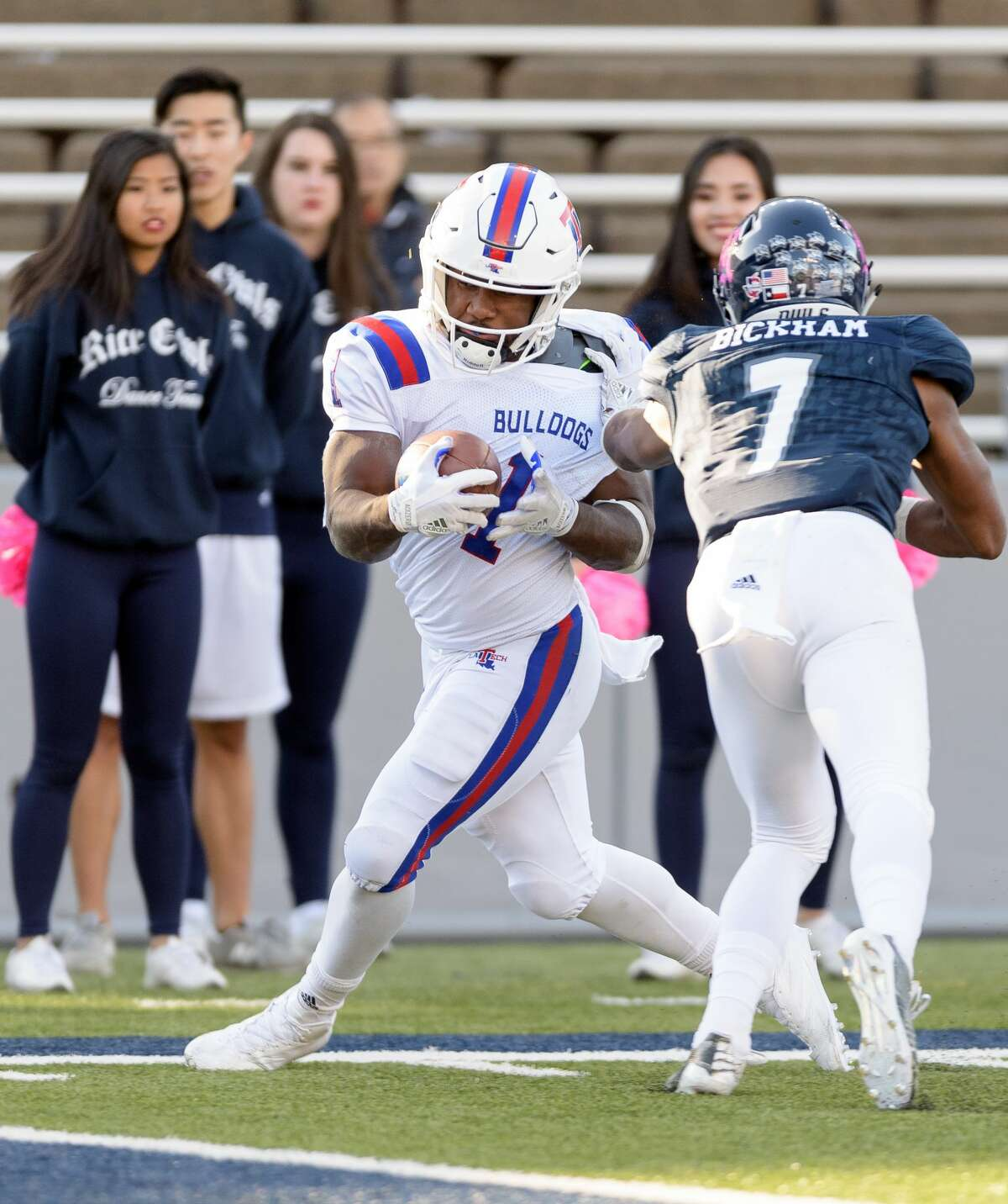 Justin Bickham (7) of the Rice Owls knocks Boston Scott (1) of the Louisiana Tech Bulldogs out of bounds just before the end zone in the second half in a Conference USA football game on Saturday, October 28, 2017 at Rice Stadium in Houston Texas.