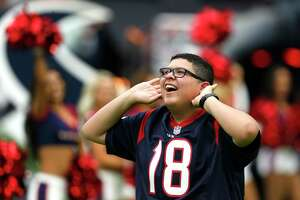 Actor Rico Rodriguez runs onto the field as the Houston Texans' Homefield Advantage Captain before an NFL football game against the Tennessee Titans at NRG Stadium on Sunday, Oct. 2, 2016, in Houston.