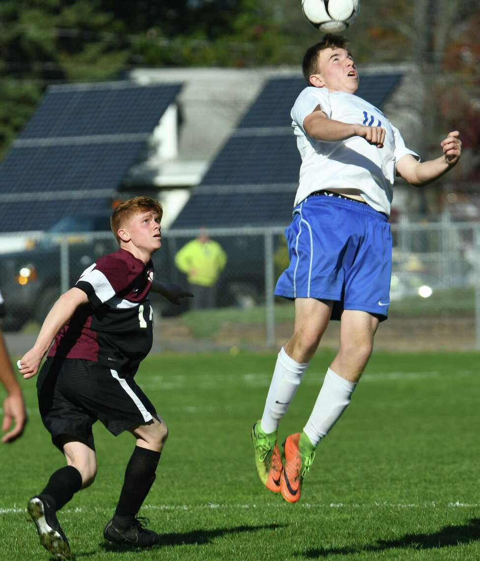 Queensbury's Aidan Jordi-Donnelly heads the ball as Burnt Hills' Jaegur DeRose looks on during the Class A boys soccer section II final on Saturday in Colonie. (Jenn March/Special to the Times Union)