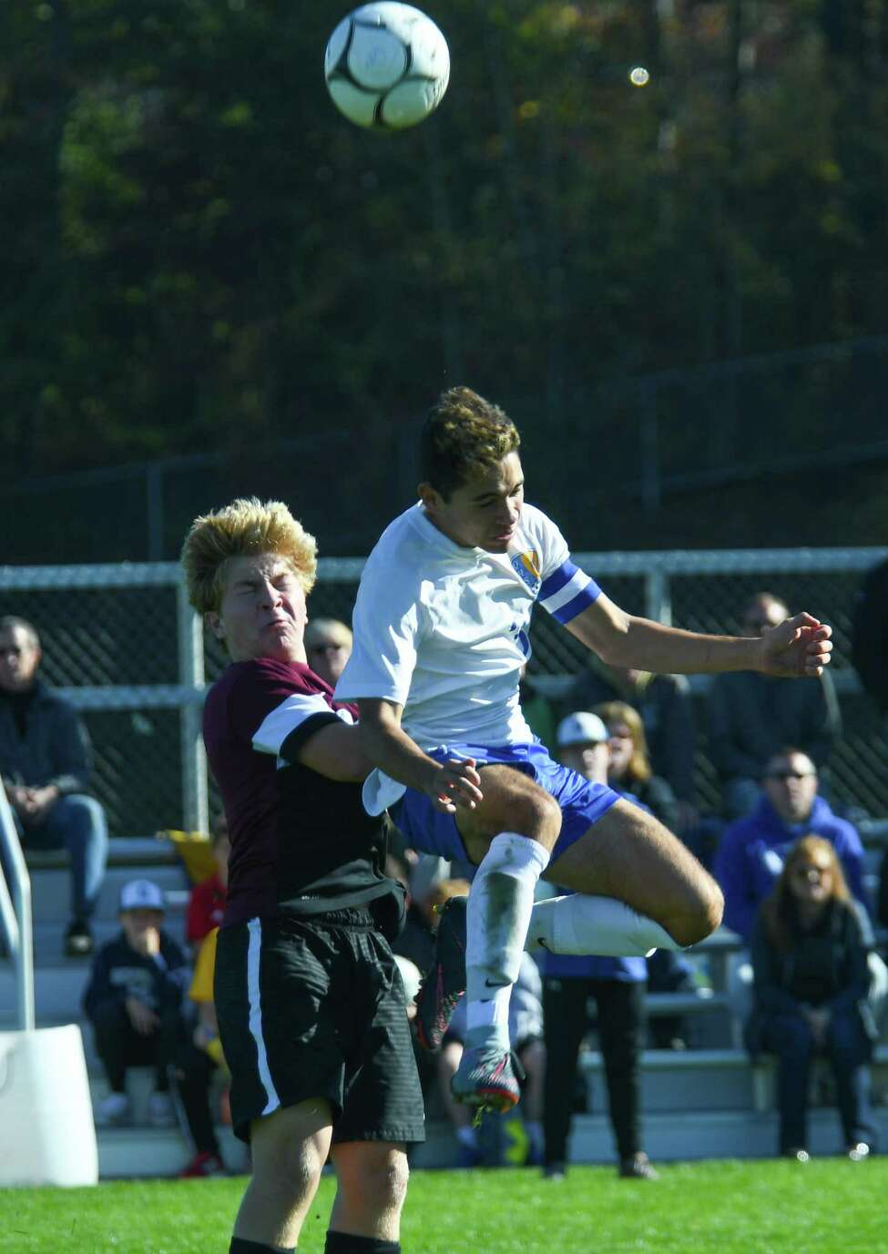 Burnt Hills' Robert Forlano reacts as Queensbury's Greg Maccharulo jumps to head the ball during the Class A boys soccer section II final on Saturday in Colonie. (Jenn March/Special to the Times Union)