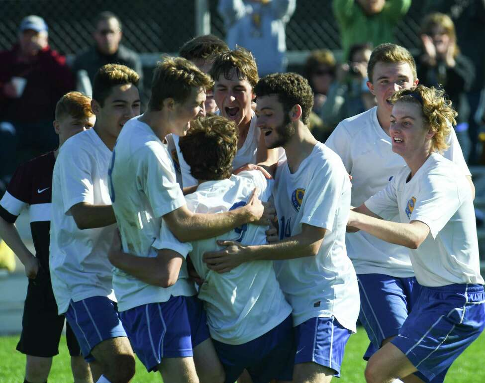 Queensbury players celebrate a goal against Burnt Hills during the Class A boys soccer section II final on Saturday in Colonie. (Jenn March/Special to the Times Union)