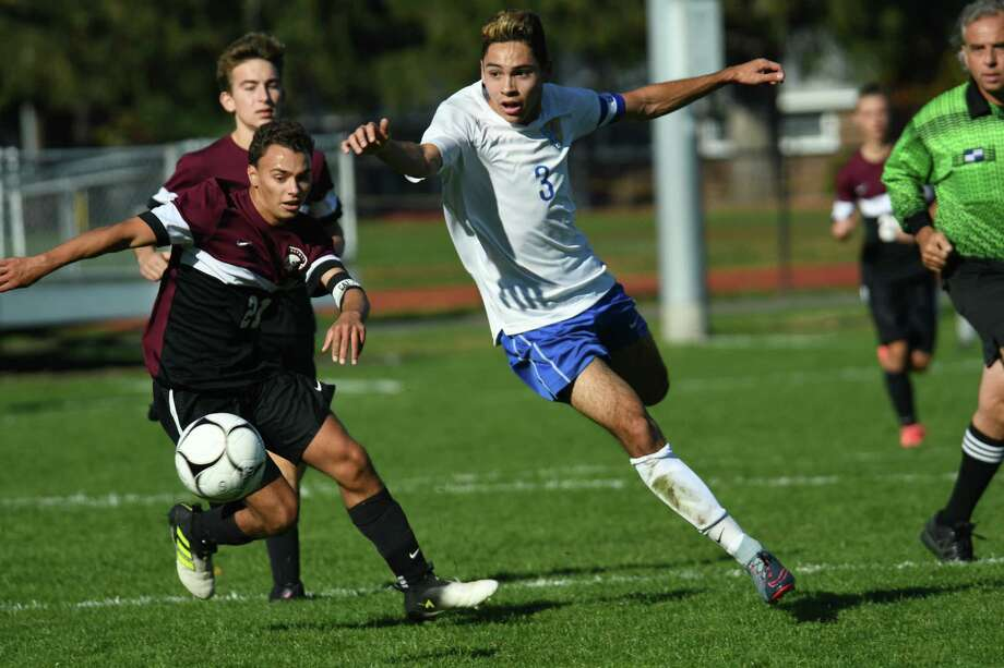 Queensbury's Greg Maccharulo and Burnt Hills' Glen Ramos pursue the ball during the Class A boys soccer section II final on Saturday in Colonie. (Jenn March/Special to the Times Union) Photo: Jenn March / 20041919A